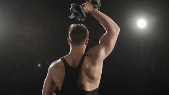 Download Healthy Young Man Training His Right Triceps. nulled download