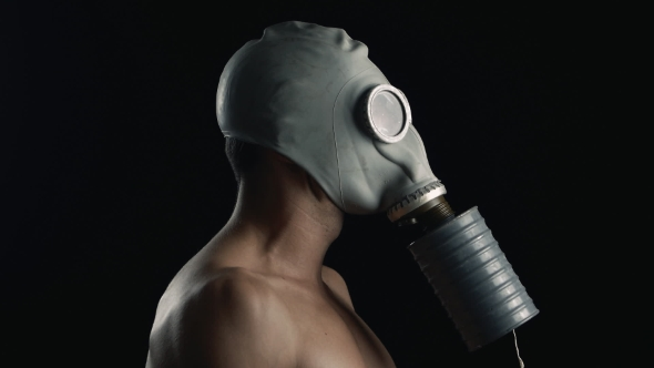Download Portrait Of a Naked Man In a Gas Mask nulled download