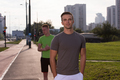 Two young men jogging through the city