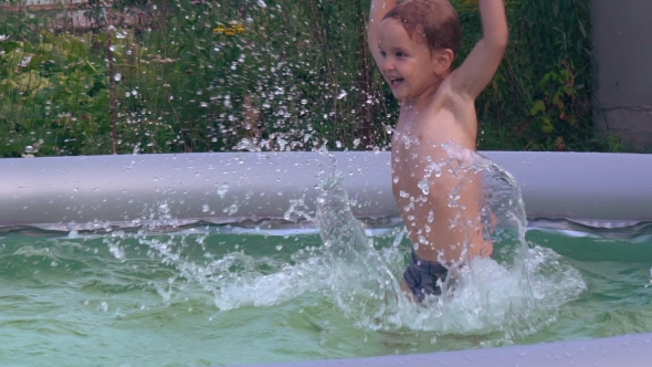 VideoHive Infant Swimming At The Open Air 18428247