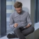 Young Job Applicant Sitting At Window And Using Tablet