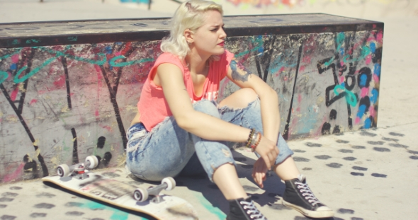 Download Young Woman Waiting At a Skate Park For a Friend nulled download