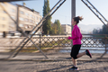 sporty woman jogging on morning