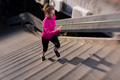 woman jogging on  steps