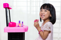 Happy Asian Chinese Liitle Girl Playing Make-Up Toys