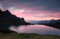 dramatic sunset over alpine lake