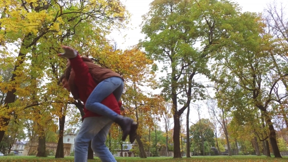 Download Happy Young Couple Having Fun In Autumn Park nulled download