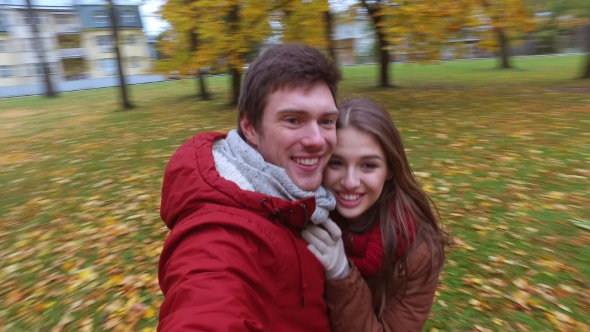 Download Happy Couple Recording Video In Autumn Park nulled download