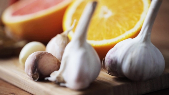 Download Ginger, Grapefruit, Orange And Garlic On Board nulled download