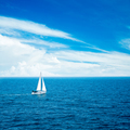 White Yacht Sailing in Blue Sea.