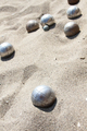 Playing of bocce in the sand