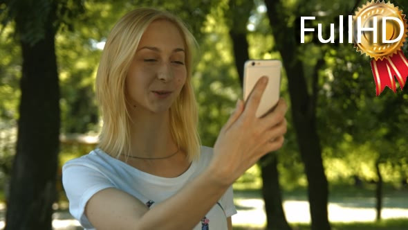 VideoHive Young Girl Takes Selfie Phone 05 18495144