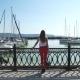 Beautiful Young Woman Walking In Marina