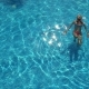 Young Woman Enjoying a Pool.