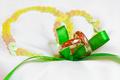 Golden wedding rings with ornament on silk background with green
