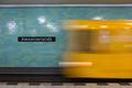 Yellow subway train in motion on Berlin Alexanderplatz underground station.