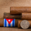 Luxury Cuban cigars with US dollar on the wooden desk