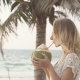 Happy Beach Bikini Woman Relaxing Drinking Fresh Coconut Water Lying Down Sunbathing On Fun
