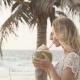 Happy Beach Bikini Woman Relaxing Drinking Fresh Coconut Water