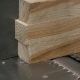 Man Using a Table Saw To Cut Wood, Grinding On Modern Furniture Factory