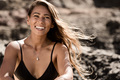 portrait of happy surfer girl at the beach. summerfeeling