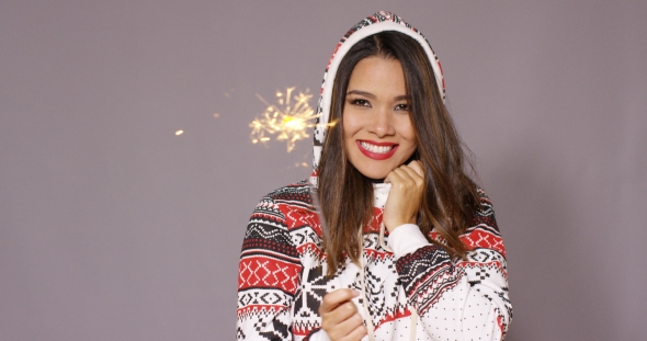 Pretty Woman Celebrating Christmas With Fireworks
