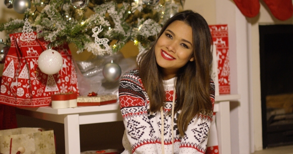 Gorgeous Young Woman Enjoying Christmas