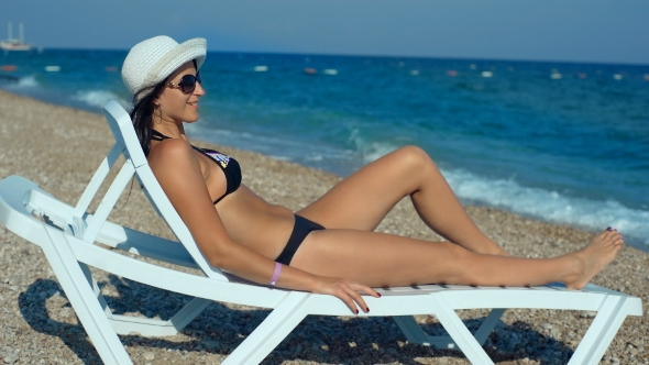 VideoHive Young Woman Lying On Sunbed 18545899