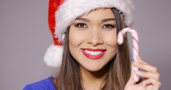 Download Sexy Young Woman In a Santa Claus Hat nulled download