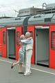 elderly couple at train station
