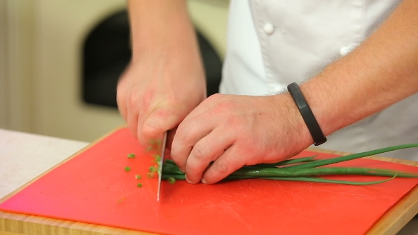 VideoHive Chopping Green Onions On a Board 18598459