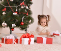 Little girl with Christmas gifts