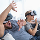 Download Couple playing videogames in VR glasses from PhotoDune