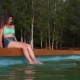 Woman Enjoying Swimming Pool