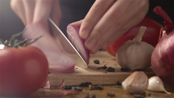 VideoHive Female Hands Cutting Onion 18614272