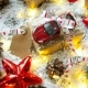 Christmas And New Year Background With Toy Car, Presents, Ribbons, Balls And Different Green