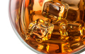 Top closeup of whiskey with ice