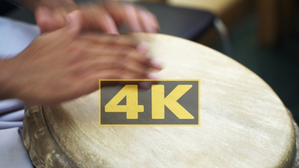 VideoHive Man's Hands Drumming Out a Beat On An Skin-covered Bongo Hand Drum 1 18622139