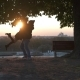 Man Whirling a Girl In The Sunlight