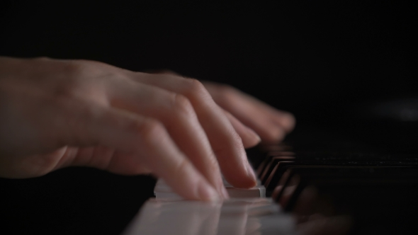 VideoHive Shallow Depth Of Field Hands Of Woman Playing Piano Keyboard Press On Black And White Key 18627118