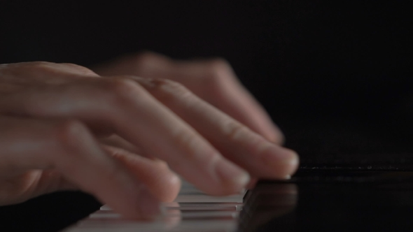 VideoHive Hands Of a Woman Playing The Piano On Black Background 18627283
