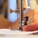 Sewing Machine, The Needle Pierces The Fabric.