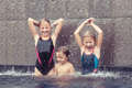 happy children  playing on the swimming pool