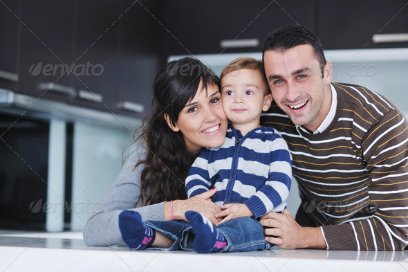 happy young family have fun  at home - Stock Photo - Images