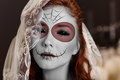 Young woman in day of the dead mask