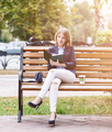 Woman sitting on the bench with diary