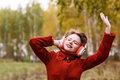 Young woman with headphones dancing