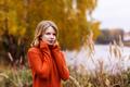 Beautiful young girl in orange sweater