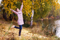 Happy young woman in forest rejoices