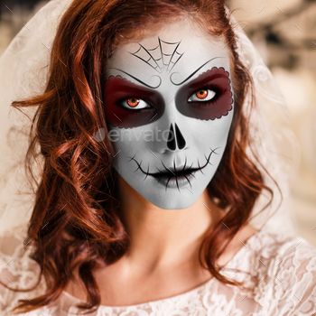 Photodune Young woman in day of the dead mask 18632681